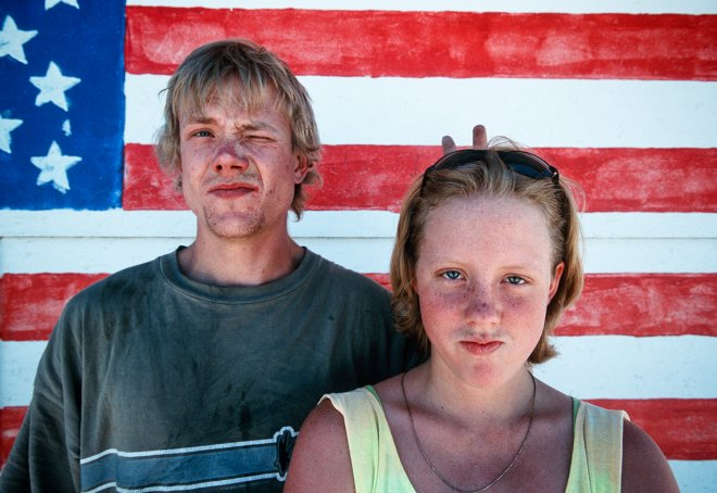 Portrait of brother and sister with americn flag in Phoenix Arizona