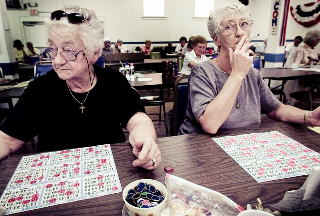 Mother and daughter play bingo and smoke