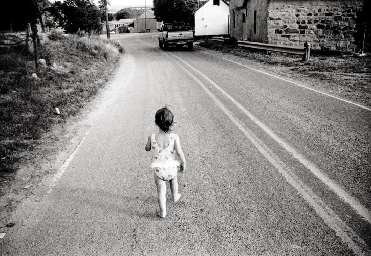 Portait of a litte girl walking on a rural street in Phoenix, Arizona
