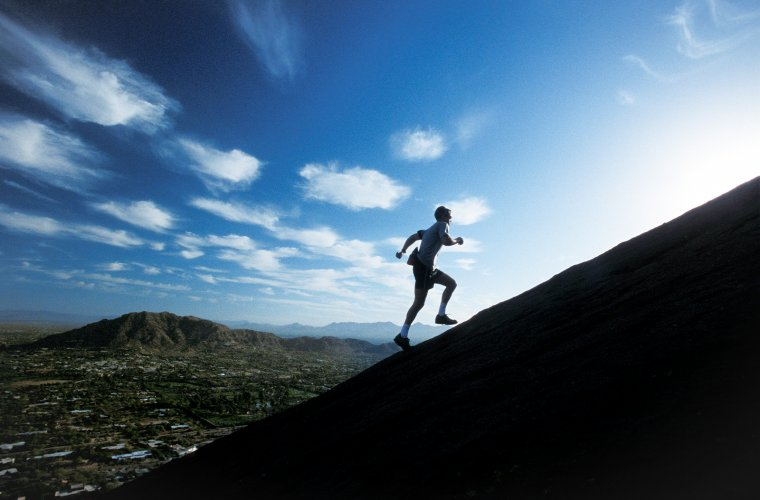 A runner tackles an aerobic climb up Camelback Mountain in Scottsdale, Arizona.