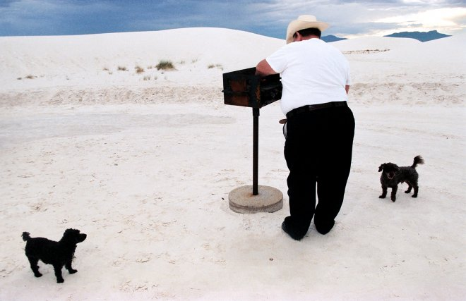 Man and his dogs barbequeing in White Sands National Park, New mexico